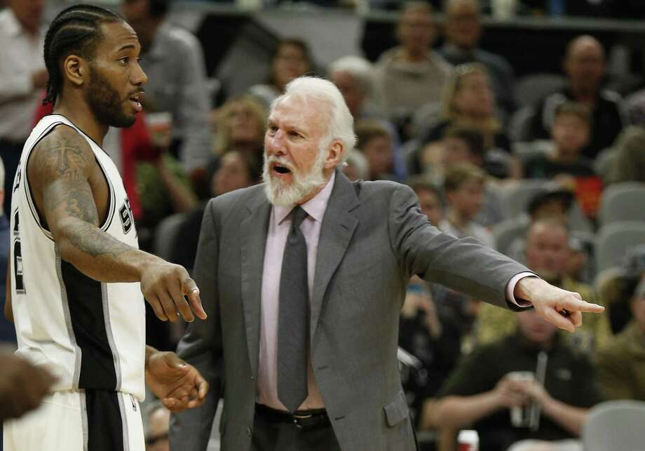 Spurs head coach Gregg Popovich tells Kawhi Leonard what happened on a play against the Portland Trail Blazers during their game at the AT&T Center on March 15. Photo: Kin Man Hui /San Antonio Express-News / ©2017 San Antonio Express-News