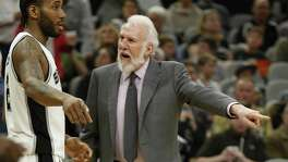Spurs head coach Gregg Popovich tells Kawhi Leonard what happened on a play against the Portland Trail Blazers during their game at the AT&T Center on March 15.