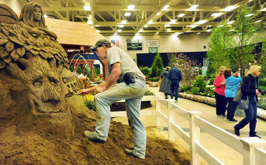 Phil Singer puts the finishing touches on his sand sculpture at the 2016 Capital District Garden & Flower Show. Singer will create a pirates and pearls-themed sculpture next week at the annual showcase in Troy. (John Carl D'Annibale / Times Union)