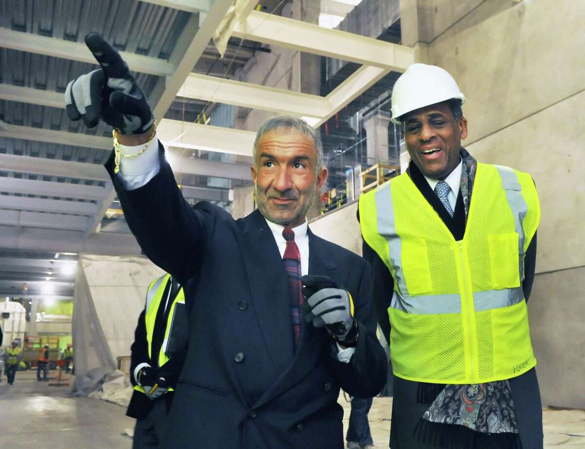 Dr. Alain E. Kaloyeros,left, Senior Vice President and Chief Executive Officer, College of Nanoscale Science and Engineering and SUNY chairman Carl McCall tour NanoFab x, Albany NanoTech's new building in Albany Tuesday Feb. 14, 2012. (John Carl D'Annibale / Times Union)