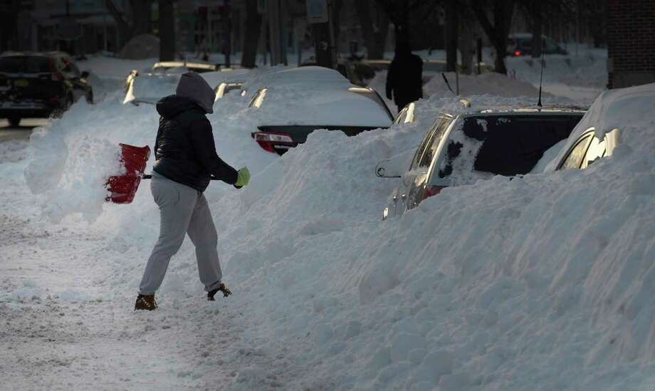 Nicole Hardy frees her car from the grasp of snow mounds on Washington Avenue following Tuesday's winter storm on Wednesday, March 15, 2017, in Albany, N.Y. (Skip Dickstein/Times Union) Photo: SKIP DICKSTEIN / 20039965A