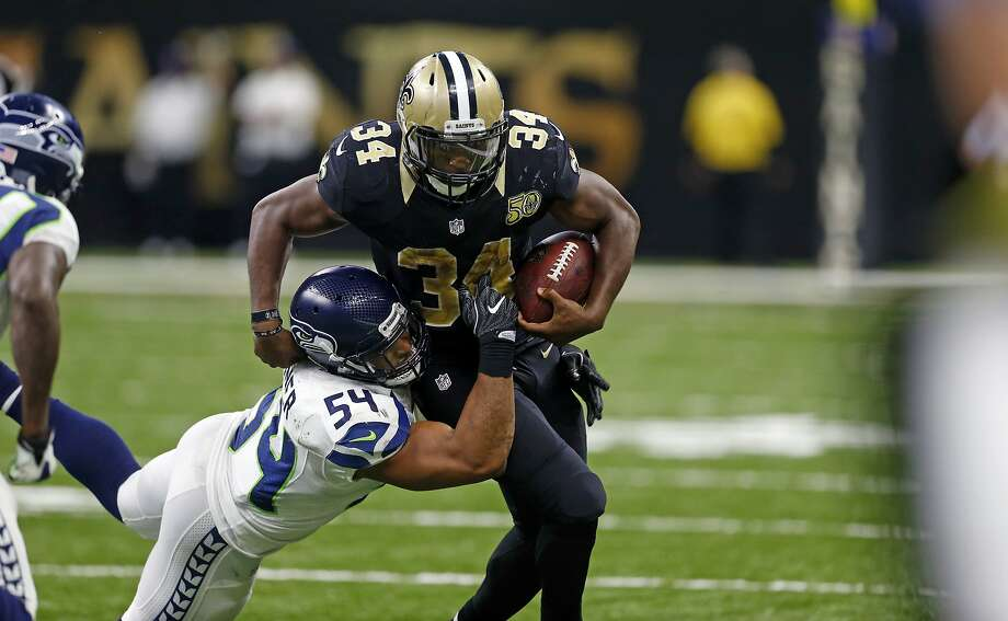 Saints running back Tim Hightower attempts to avoid Seahawks linebacker Bobby Wagner in October. Photo: Butch Dill, AP