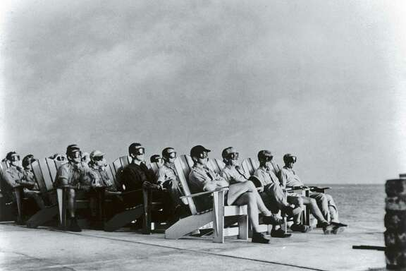 High ranking military personnel sitting in rows of deck chairs & wearing goggles while getting illuminated by flare of atomic detonation at Atomic Energy Commission's Pacific Proving Ground during Operation Greenhouse.  (Photo by Time Life Pictures/Us Air Force/The LIFE Picture Collection/Getty Images)