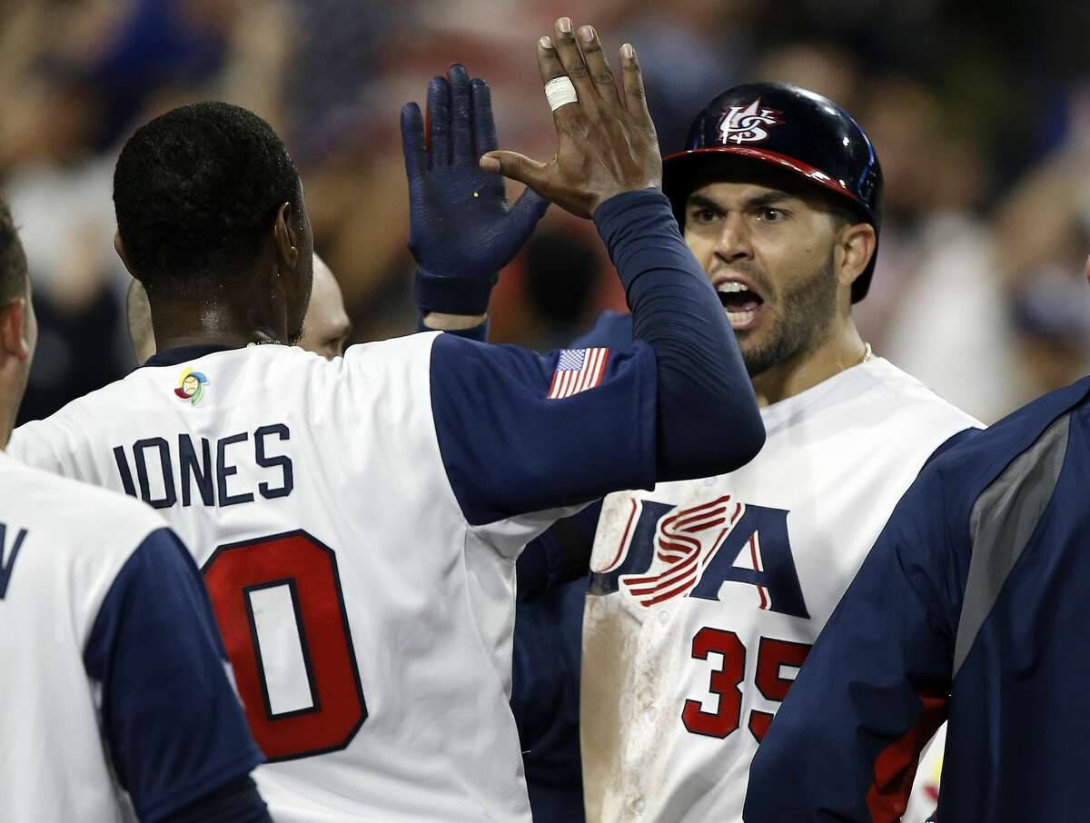 United States' Adam Jones, left, celebrates with Eric Hosmer, right, after Hosmer hit a two-run home run against Venezuela during the eighth inning of a second-round World Baseball Classic game in San Diego, Wednesday, March 15, 2017. The United States won 4-2. (AP Photo/Alex Gallardo)