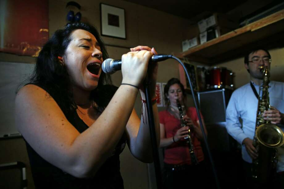 Diana Trujillo sings while Morgan Nilsen and Justin Chin play as La Misa Negra rehearses in Oakland, Calif., on Wednesday, March 15, 2017. Photo: Scott Strazzante, The Chronicle
