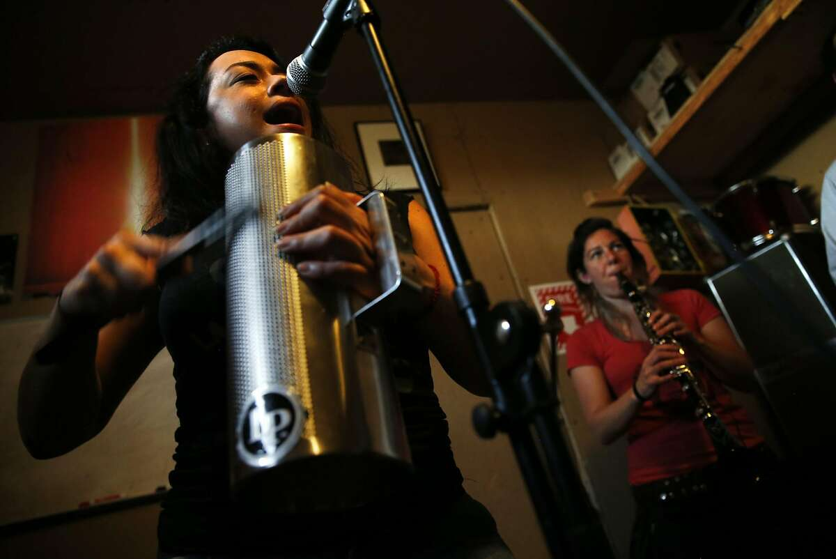 Diana Trujillo sings while Morgan Nilsen plays the clarinet as La Misa Negra rehearses in Oakland, Calif., on Wednesday, March 15, 2017.