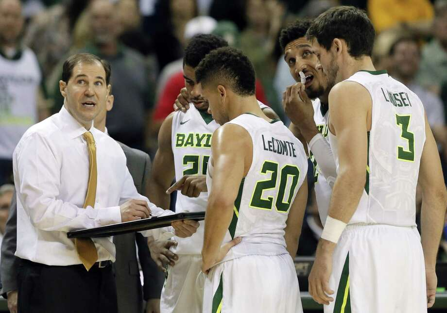 Baylor coach Scott Drew draws up a play during a time out in the second half against Oklahoma in Waco on Feb. 21, 2017. While the Bears have been to two Elite Eights under coach Drew, their most recent March memories are getting upset by double-digit seeds each of the last two years. Photo: Tony Gutierrez /Associated Press / Copyright 2017 The Associated Press. All rights reserved.