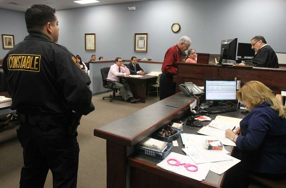 A truancy hearing gets underway in 2012 at the Bexar County Precinct 2 Court. Following Bexar County's example, the state decriminalized truancy two years ago. Now a $1.2 million grant to the city will allow the hiring of an additional 20 caseworkers to work directly with area school districts to keep students in class. Photo: Express-News File Photo / SAN ANTONIO EXPRESS-NEWS (Photo can be sold to the public)