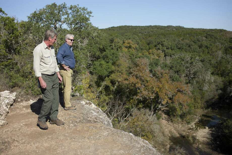 Dr. Thomas L. Adams (right), Witte Museum curator of paleontology and geology, speaks with trail manager John Koepke on Nov. 29, 2016, at Government Canyon State Natural Area in San Antonio. Photo: Darren Abate /For The Express-News