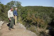 Dr. Thomas L. Adams (right), Witte Museum curator of paleontology and geology, speaks with trail manager John Koepke on Nov. 29, 2016, at Government Canyon State Natural Area in San Antonio.