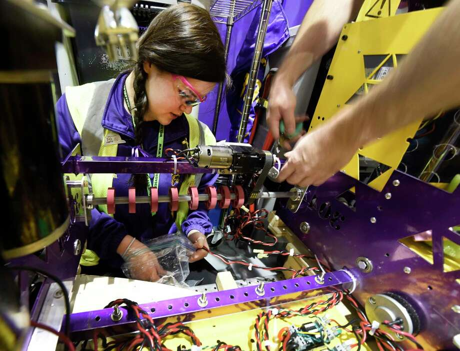 Maddie Welch,17, of the Ballston Spa High School team works on her FIRST Robotics Competition robot at RPI Thursday March 16, 2017 in Troy, N.Y.   The FIRST Robotics Competition combines the excitement of sports with the rigors of science and technology. The competition phase of the event begins Friday after a day of assembly and practice today and competition continues through Saturday. ( (Skip Dickstein/Times Union) Photo: SKIP DICKSTEIN / 20039977A