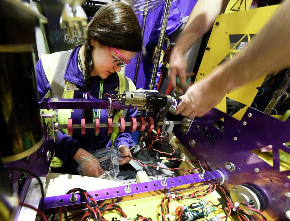Maddie Welch,17, of the Ballston Spa High School team works on her FIRST Robotics Competition robot at RPI Thursday March 16, 2017 in Troy, N.Y. The FIRST Robotics Competition combines the excitement of sports with the rigors of science and technology. The competition phase of the event begins Friday after a day of assembly and practice today and competition continues through Saturday. ( (Skip Dickstein/Times Union)