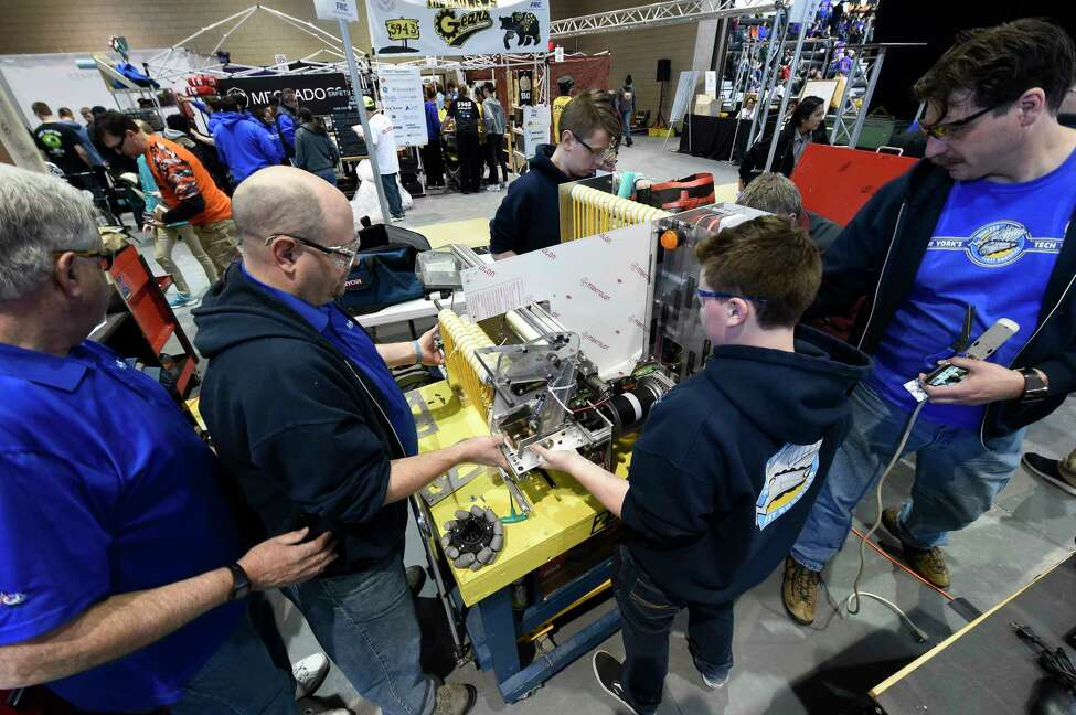 Members of the Colonie High School team move their robot to the work bench for assembly at FIRST Robotics Competition robot at RPI Thursday March 16, 2017 in Troy, N.Y. The FIRST Robotics Competition combines the excitement of sports with the rigors of science and technology. The competition phase of the event begins Friday after a day of assembly and practice today and competition continues through Saturday. ( (Skip Dickstein/Times Union)