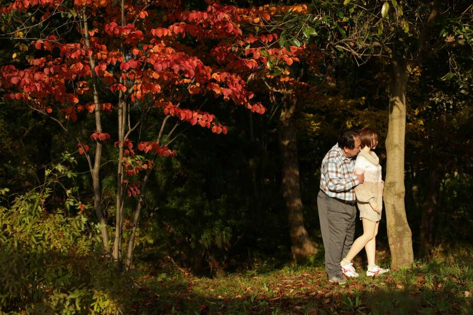 """ISHIKAWA, JAPAN - NOVEMBER 12:  Senji Nakajima enjoy walking with his love doll Saori on November 12, 2016 in Ishikawa, Japan. Senji Nakajima, 60 years old, lives with his life-size 'love doll' named 'Saori' in his apartment in Tokyo, Japan. Nakajima, married with two children, who lives away from home for work, first started his life with Saori six years ago. At first, he used to imagine as if the doll was his first girl friend, and used it only for sexual purposes to fill the loneliness, but months later, he started to find Saori actually has an original personality. """"She never betrays, not after only money. I'm tired of modern rational humans. They are heartless,"""" Nakajima says, """"for me, she is more than a doll. Not just a silicon rubber. She needs much help, but still is my perfect partner who shares precious moments with me and enriches my life.""""  (Photo by Taro Karibe/Getty Images) Photo: Taro Karibe/Getty Images"""