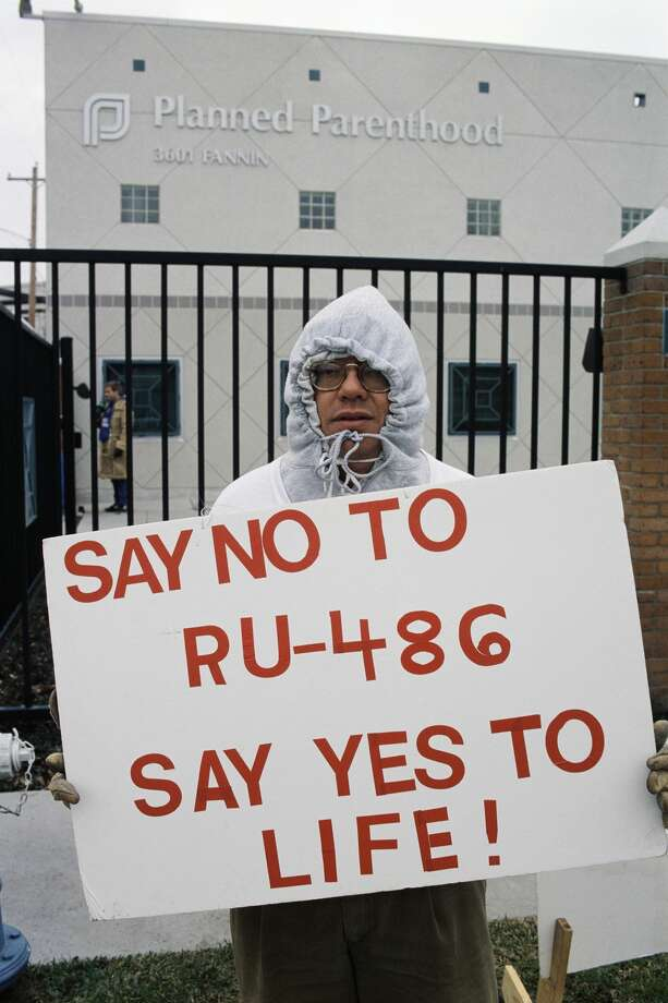 "Anti-abortion activist William Burban holds a sign protesting RU-486 outside of a Planned Parenthood clinic in Houston, Texas. RU-486, the ""abortion pill,"" is used to terminate pregnancies within the first seven weeks of conception. (Photo by �� Greg Smith/CORBIS/Corbis via Getty Images) Photo: Gregory Smith/Corbis Via Getty Images"