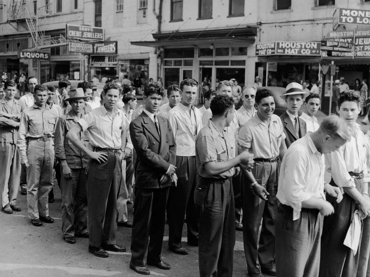 PHOTOS: How Texas reacted to World War II A line of inducted men are pictured on their way to a military reception center in Houston in May 1943. Click through to see images of Texas during WWII...