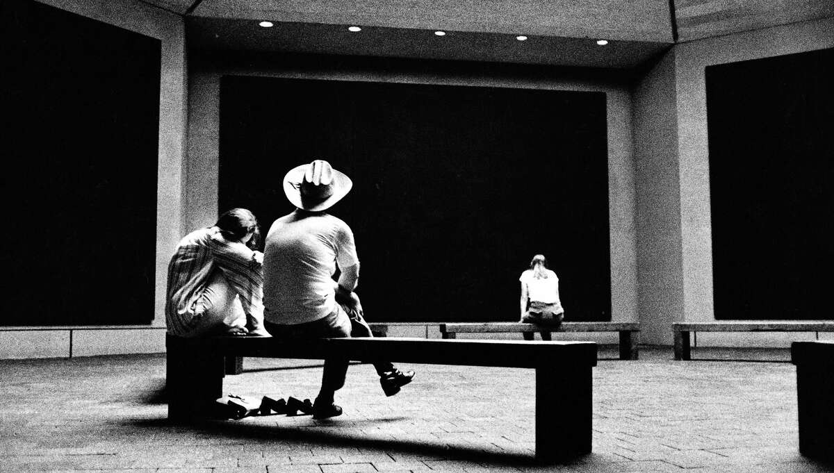 Visitors at the Rothko Chapel, seen here in 1977. Completed in 1971, it was designed in collaboration with American painter Mark Rothko and contains fourteen of his black paintings.