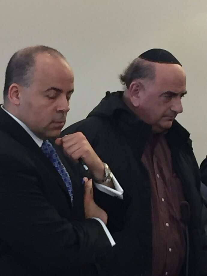 "Former Independence Party leader Lawrence Rosenbaum, right, was sentenced to three to nine years in prison by a judge who slammed him as a ""con man"" and ""flim-flam artist"" for two scams including one where he impersonated his deceased son so he and his wife could scam $12,500 from an insurance company. (Robert Gavin / Times Union)"
