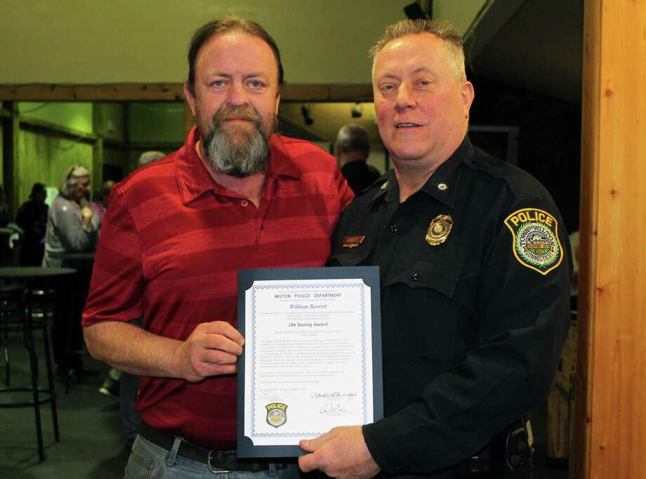Kevin Woulfe and Wilton police Officer William Barrett, who received the Life Saving Award at the department's annual awards ceremony on Monday. Photo: Stephanie Kim / Hearst Connecticut Media