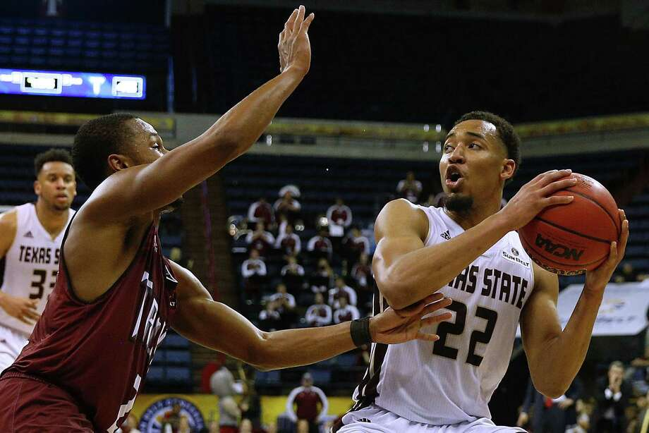 NEW ORLEANS, LA - MARCH 12: Nijal Pearson #22 of the Texas State Bobcats drives against Jeremy Hollimon #2 of the Troy Trojans during the second half of a game in the final round of the Sun Belt Basketball Tournament at UNO Lakefront Arena on March 12, 2017 in New Orleans, Louisiana.  (Photo by Jonathan Bachman/Getty Images) Photo: Jonathan Bachman, Stringer / 2017 Getty Images