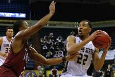 NEW ORLEANS, LA - MARCH 12: Nijal Pearson #22 of the Texas State Bobcats drives against Jeremy Hollimon #2 of the Troy Trojans during the second half of a game in the final round of the Sun Belt Basketball Tournament at UNO Lakefront Arena on March 12, 2017 in New Orleans, Louisiana.  (Photo by Jonathan Bachman/Getty Images)