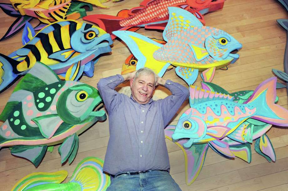 Redding artist James Grashow with corrugated board sculptures of fish that will be featured in his upcoming show titled, Corrugated World: The Art of James Grashow, at the Flinn Gallery on the second floor of Greenwich Library. The show opened Thursday and runs through April 26. Photo: Bob Luckey Jr. / Hearst Connecticut Media / Greenwich Time