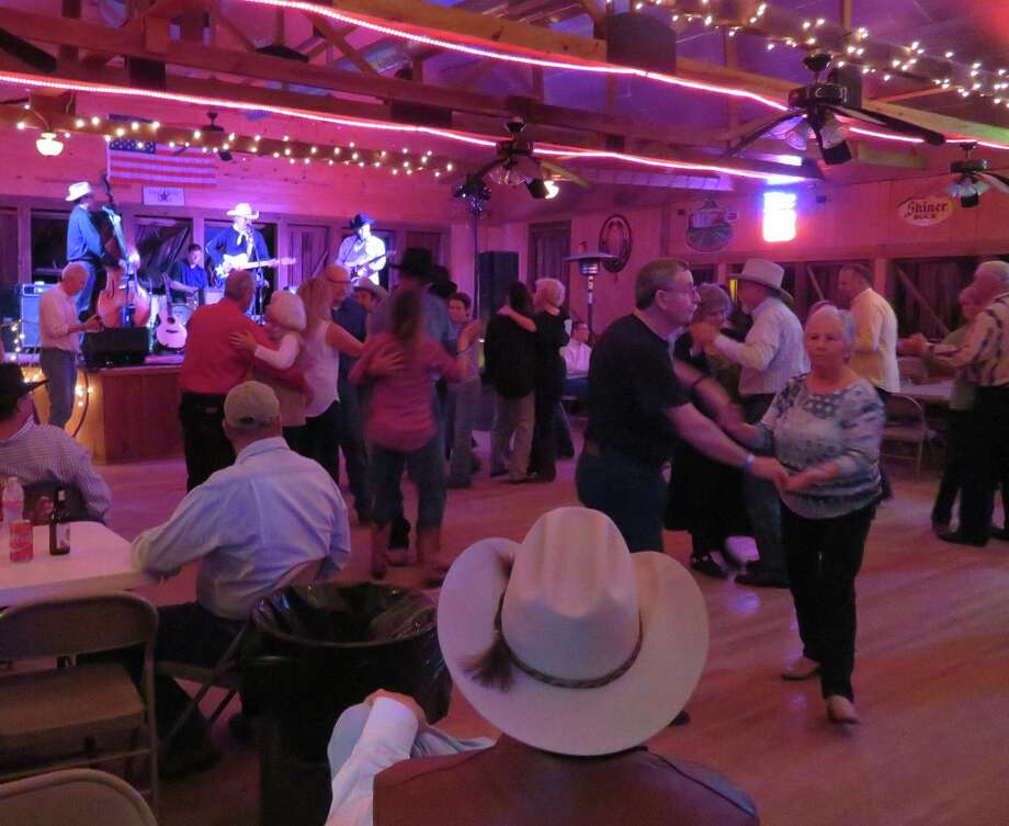 An enthusiastic and experienced crowd fills the dance floor at the historic Kendalia Halle on Saturday night. Photo: Terry Scott Bertling / San Antonio Express-News