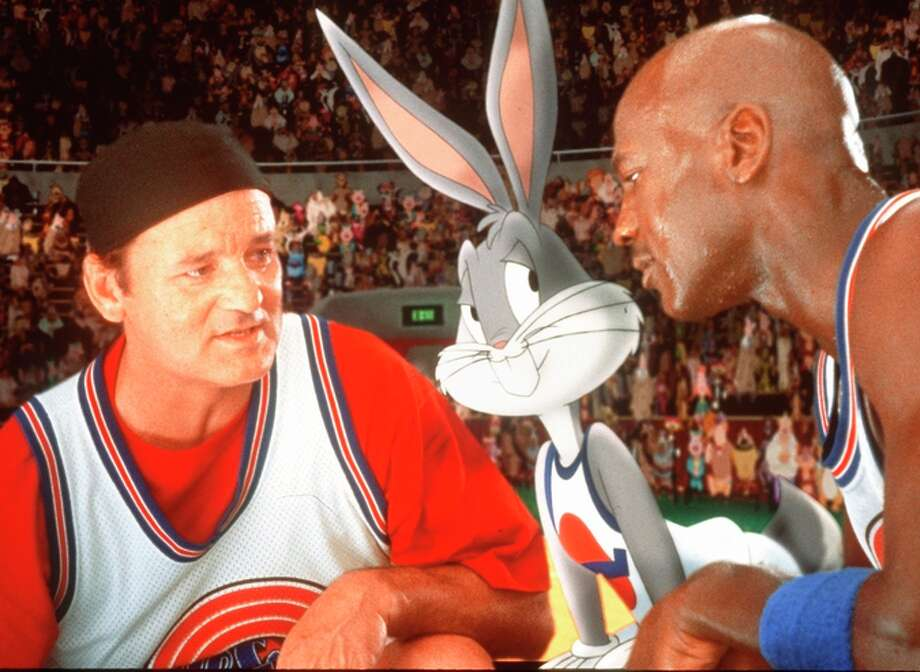 """Bill Murray and Michael Jordan (with Bugs Bunny) in a still from """"Space Jam."""" Photo: Associated Press"""