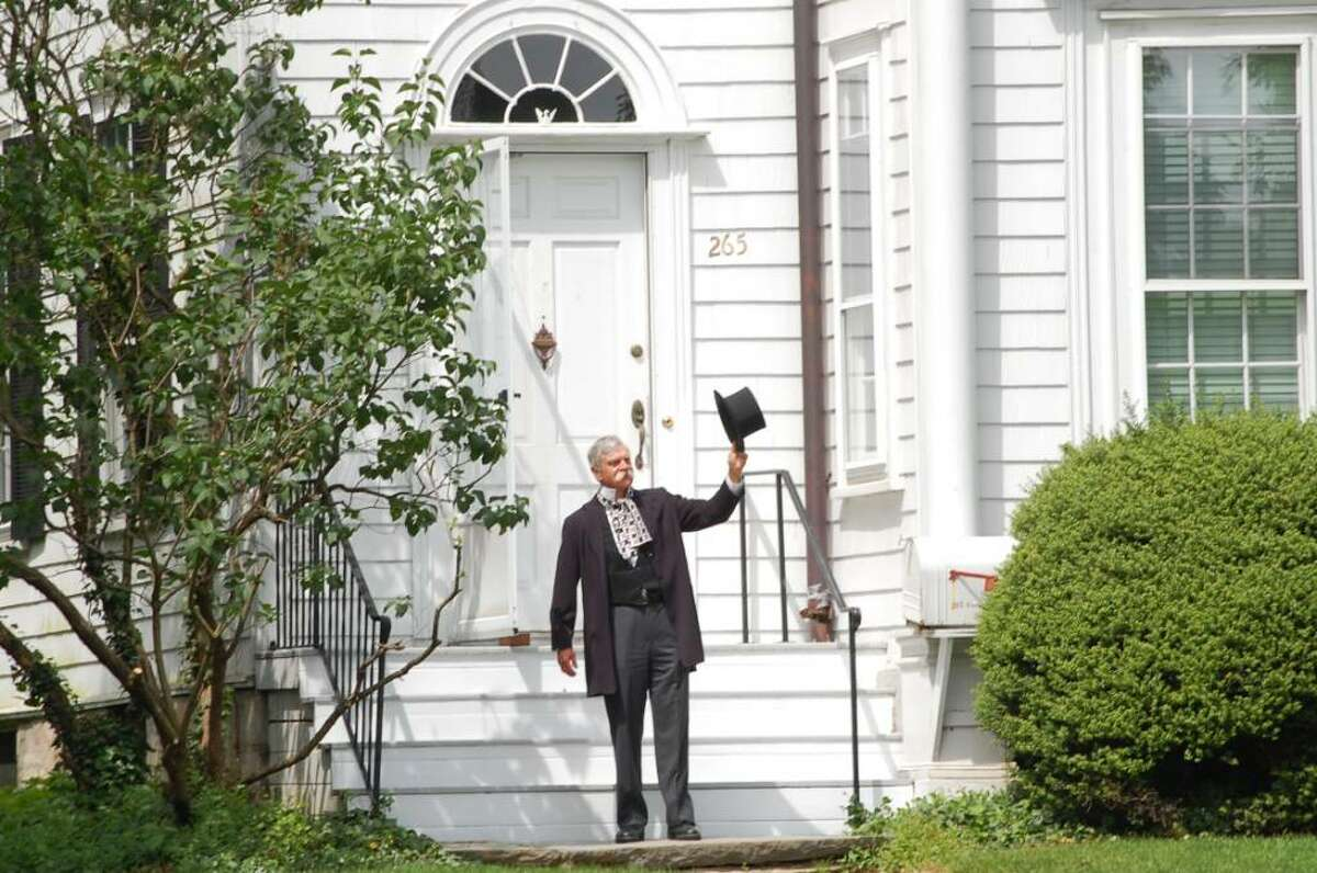 Carl Leaman (portraying Ebenezer Jesup) stands in front of the parsonage of the Saugatuck Congregational Church, which used to be Jesup's home.