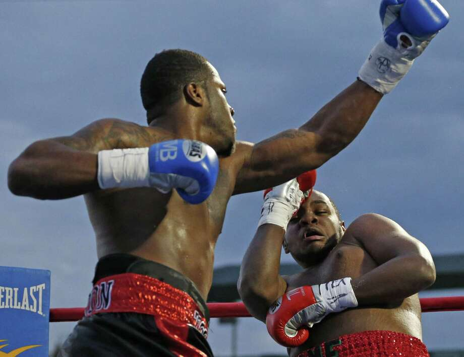 Heavweight Tyrell Herndon (left) punches Jerome Aiken during a pro boxing bout at Wolff Stadium on Nov. 14, 2015. Photo: Ron Cortes /For The Express-News
