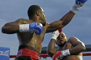 Heavweight Tyrell Herndon (left) punches Jerome Aiken during a pro boxing bout at Wolff Stadium on Nov. 14, 2015.