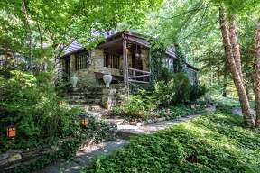 "Stone cabin, New Milford $225 a night Description:  The ""gemutlich"" ambiance of an original 30s lake house with its fieldstone walls, pine shiplap paneling, vaulted ceilings, wood-burning fireplace, and period antiques is what makes this house so charming. Flooded with natural light, with lake or lush green forest seen from every room, this is the perfect place to relax and enjoy the feeling of home. View full listing on Airbnb"