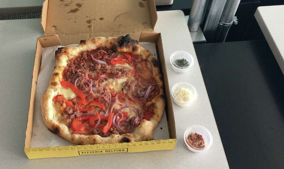 """Mission favorites: Pizzeria Delfina (pictured) vs. Patxi'sPizzeria DelfinaPrice (without tip): $23.71, for one SalsicciaDelivery length: 41 minutes, 2.1 miles distanceHotness: 3.3First bite: 6Total averaged score: 4.66Comments: """"Explosion of clean and bold flavors""""""""Great flavor balance, but crust not great — chewy and soggy, while at same time overloaded (with toppings)"""""""