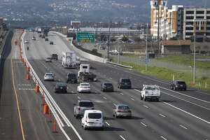Commuters roll past express lanes on westbound Interstate 580 in Pleasanton, Calif. on Tuesday, Feb. 9, 2016. The new lanes which may cost up to $13 for solo drivers to travel for the entire 14-mile corridor, is scheduled to open before the end of the month.