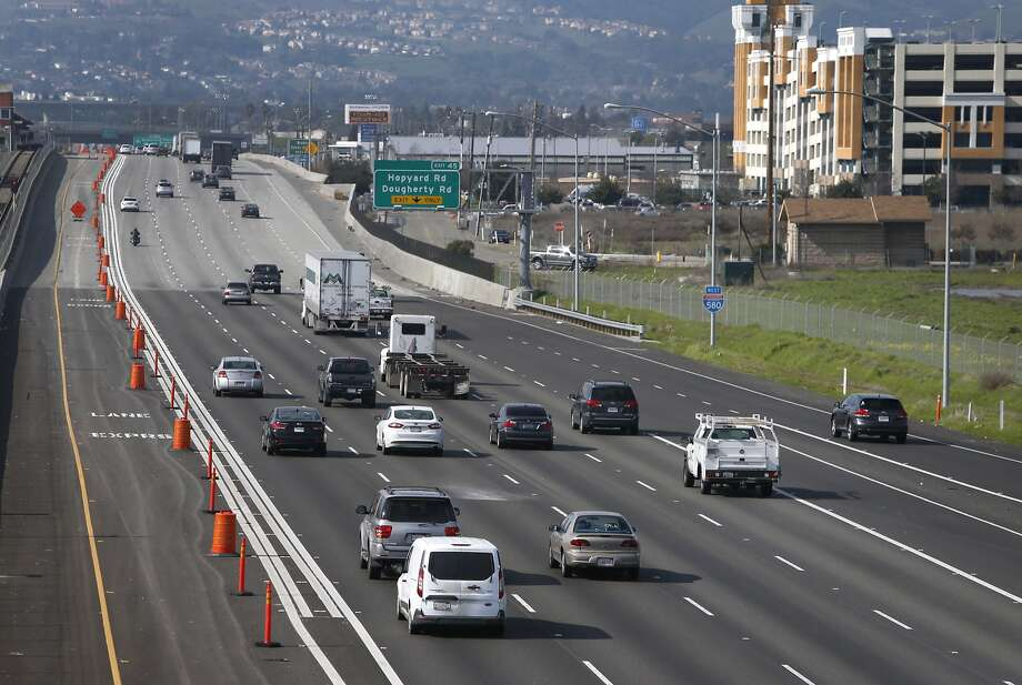 Commuters roll past express lanes on westbound Interstate 580 in Pleasanton, Calif. on Tuesday, Feb. 9, 2016. The lanes, now a year old, have been popular for drivers willing to pay money for a faster commute, a new report says. Photo: Paul Chinn, The Chronicle