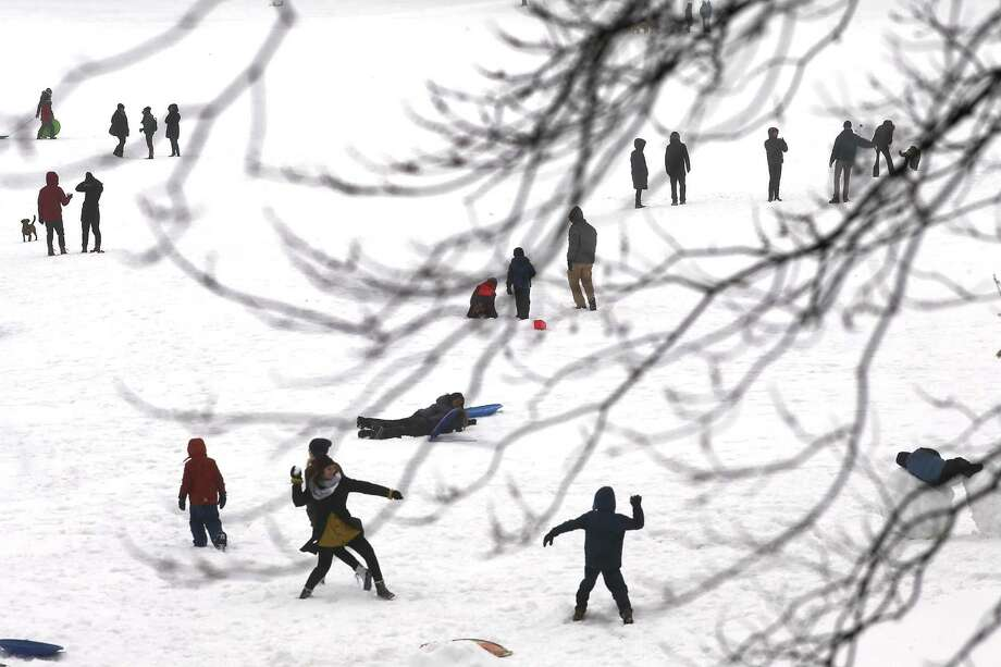 NEW YORK, NY - MARCH 14: People enjoy and afternoon in the sleet and snow in Brooklyn on March 14, 2017 in New York City. New York City and New Jersey experienced near blizzard conditions as the late winter storm brought up to seven inches of snow to the area. Schools, flights, businesses and public transportation are closed or restricted throughout the area.  (Photo by Spencer Platt/Getty Images) *** BESTPIX *** Photo: Spencer Platt / 2017 Getty Images