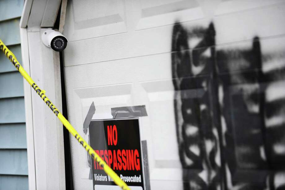 The security camera positioned on the garage of a vandalized home in Stamford was off during the time of a recent incident in which racist graffiti was sprayed on the door. Photo: Michael Cummo / Hearst Connecticut Media / Stamford Advocate
