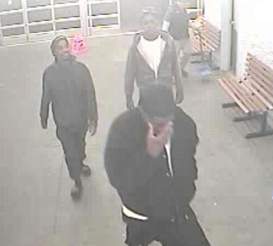 Surveillance  photos of suspects wanted by the Lumberton Police Department in connection with a lawnmower stolen from Walmart. Photo: Lumberton Police Department