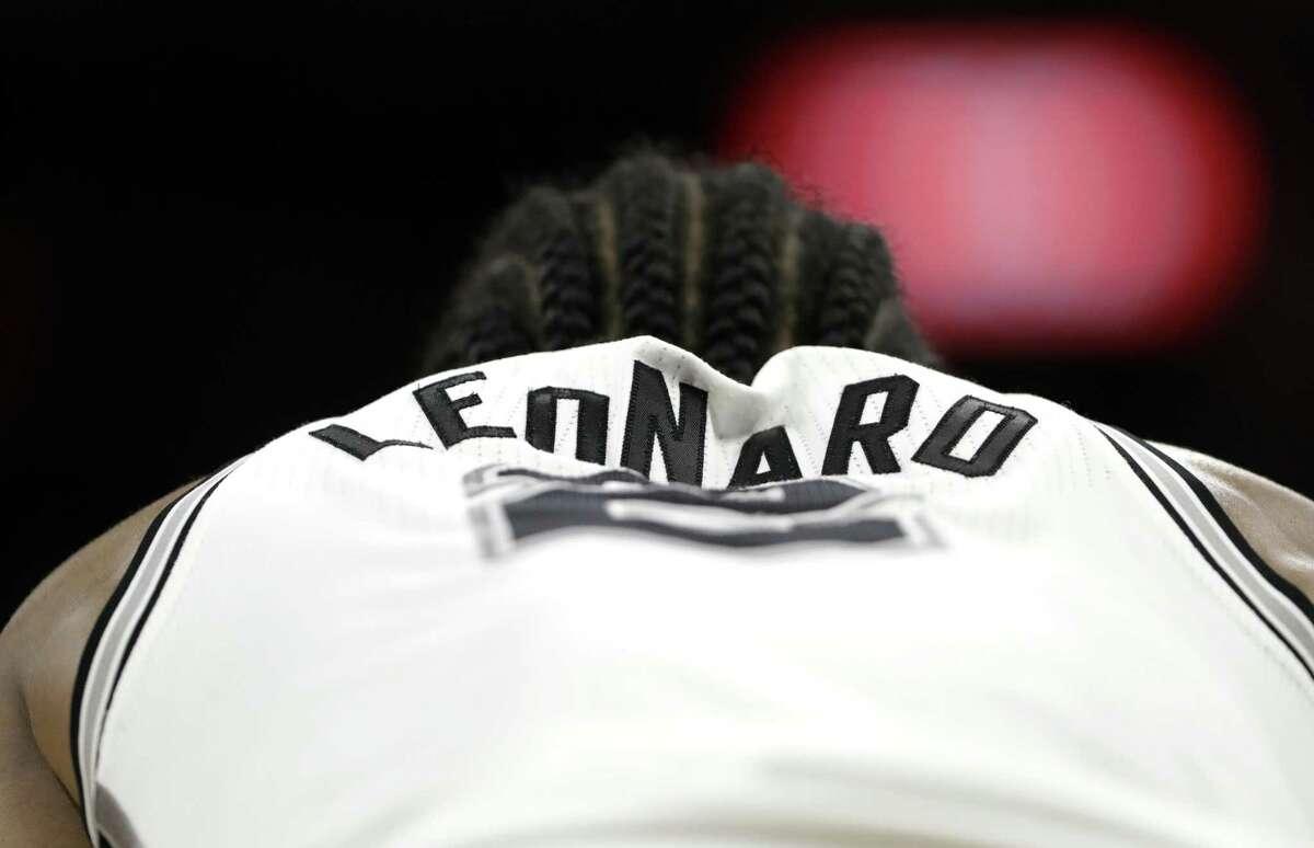 Kawhi Leonard waits for play to resume on March 15.