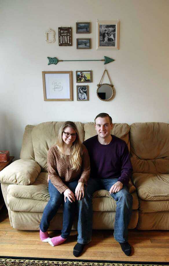 Amanda Fires and Tim Gilroy in their State Street apartment on Friday, March 10, 2017, in Albany, N.Y. The couple are looking to purchase a home. (Will Waldron/Times Union) Photo: Will Waldron / 20039900A
