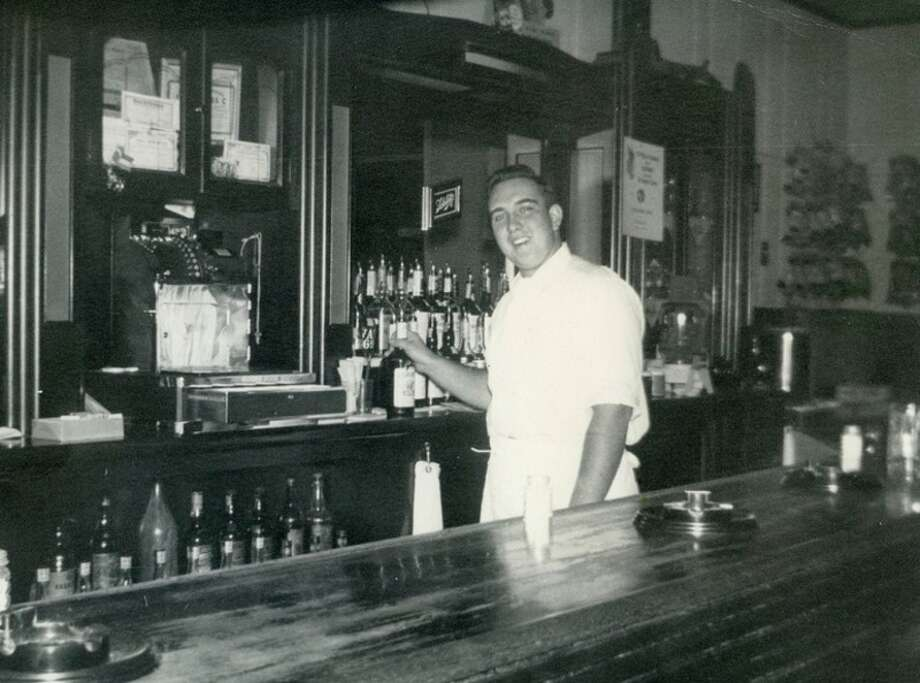 Cora and Earl Miller owned a bar and restaurant in East Detroit.  This is their son Dick waiting on customers behind the counter.  Dick attended Michigan State University and became a chef.