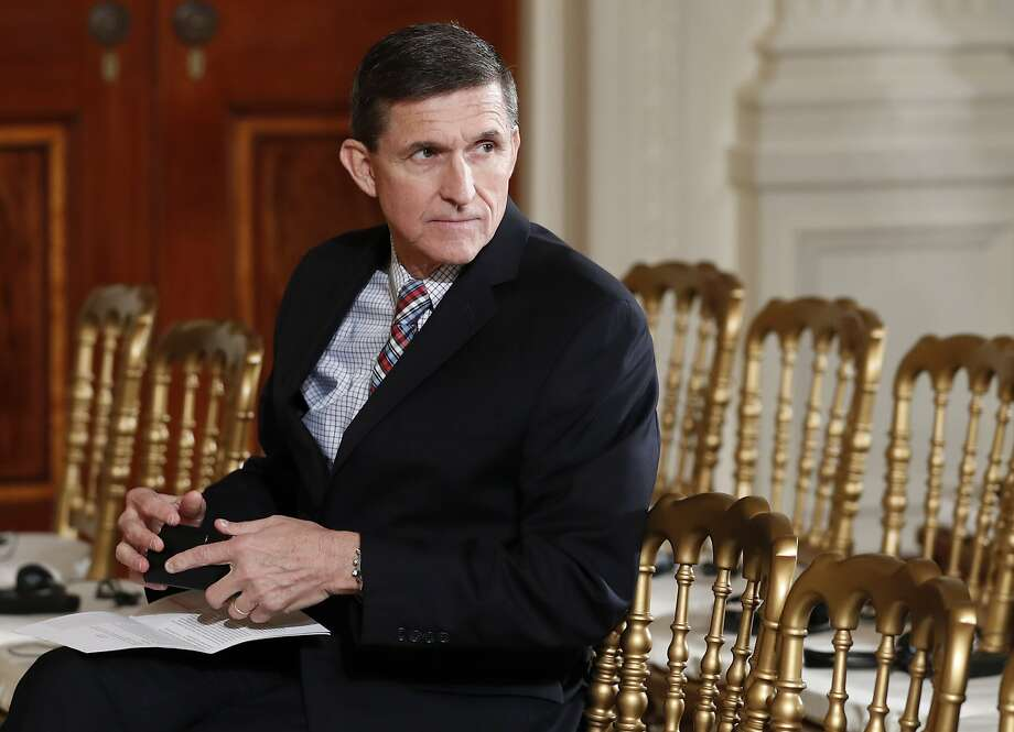 In this Feb. 10, 2017 file photo, then-National Security Adviser Michael Flynn sits in the East Room of the White House in Washington. Documents released in a congressional inquiry show Flynn was paid more than $33,750 by RT, Russia's government-run television system, for appearing at a Moscow event in December 2015. Flynn had retired months earlier as head of the U.S. Defense Intelligence Agency. (AP Photo/Carolyn Kaster, File) Photo: Carolyn Kaster, Associated Press