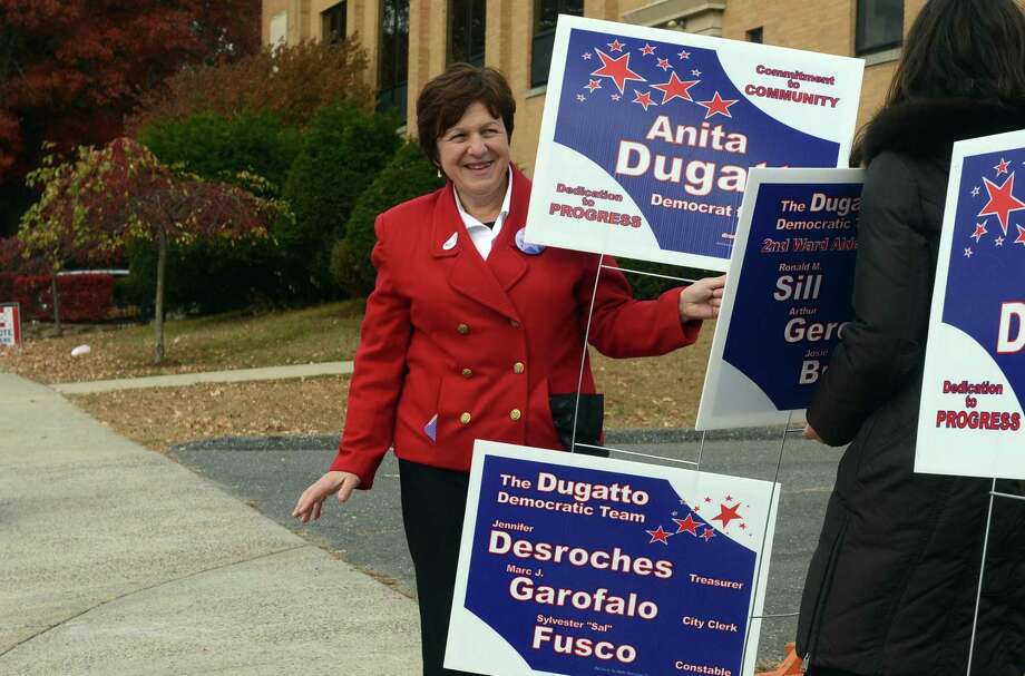 Derby Mayor Anita Dugatto campaigns outside Irving School during her historic 2013 win becoming the first female mayor in the city's history. Photo: Autumn Driscoll / Autumn Driscoll / Connecticut Post