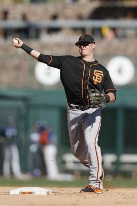 GLENDALE, AZ - MARCH 07:  Christian Arroyo #22 of the San Francisco Giants throws to first in the eighth inning for an out against the Los Angeles Dodgers during the spring training game at Camelback Ranch on March 7, 2017 in Glendale, Arizona.  (Photo by Tim Warner/Getty Images)