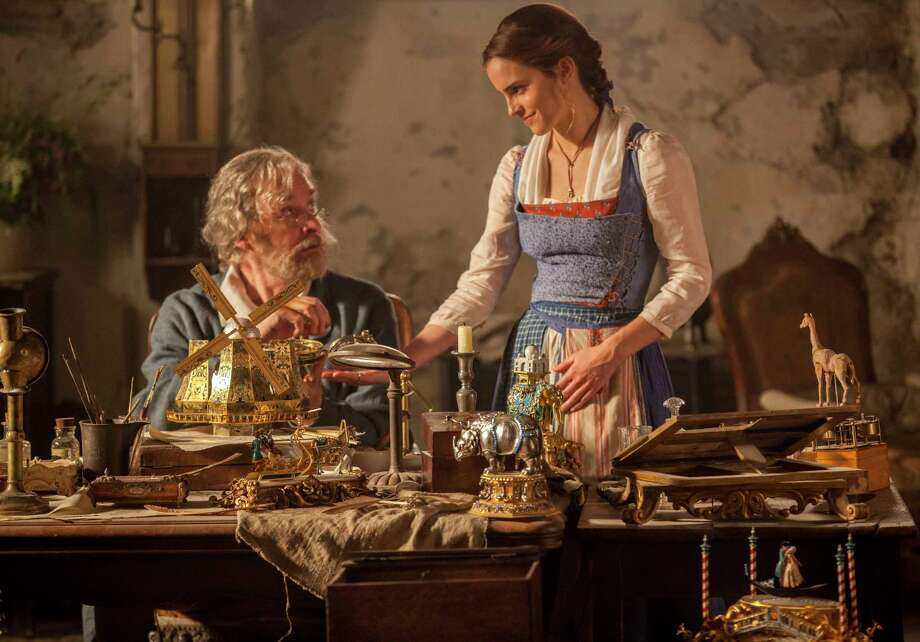 "This image released by Disney shows Emma Watson as Belle, right, and Kevin Kline as Maurice in a scene from ""Beauty and the Beast."" (Laurie Sparham/Disney via AP) ORG XMIT: NYET139 Photo: Laurie Sparham / © 2016 Disney Enterprises, Inc. All Rights Reserved."
