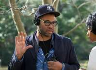 "Writer-director Jordan Peele on the set of ""Get Out."" MUST CREDIT: Justin Lubin, Universal Pictures"