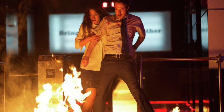 """John Gallagher Jr., right, and Adria Arjona star in """"The Belko Experiment."""""""