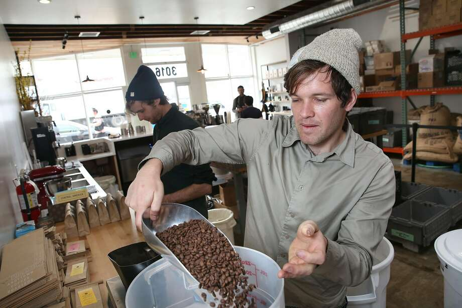 Scott Lingner packages decaf coffee beans at Andytown Coffee Roasters on Taraval. Photo: Liz Hafalia, The Chronicle