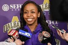 University at Albany women's basketball player Imani Tate talks to the press after finding out her team will be competing against Connecticut in the NCAA Tournament during a viewing party in the Hall of Fame room at SEFCU Arena on Monday, March 13, 2017 in Albany, N.Y. UConn as has won 107 consecutive games and is the No. 1 seed. (Lori Van Buren / Times Union)