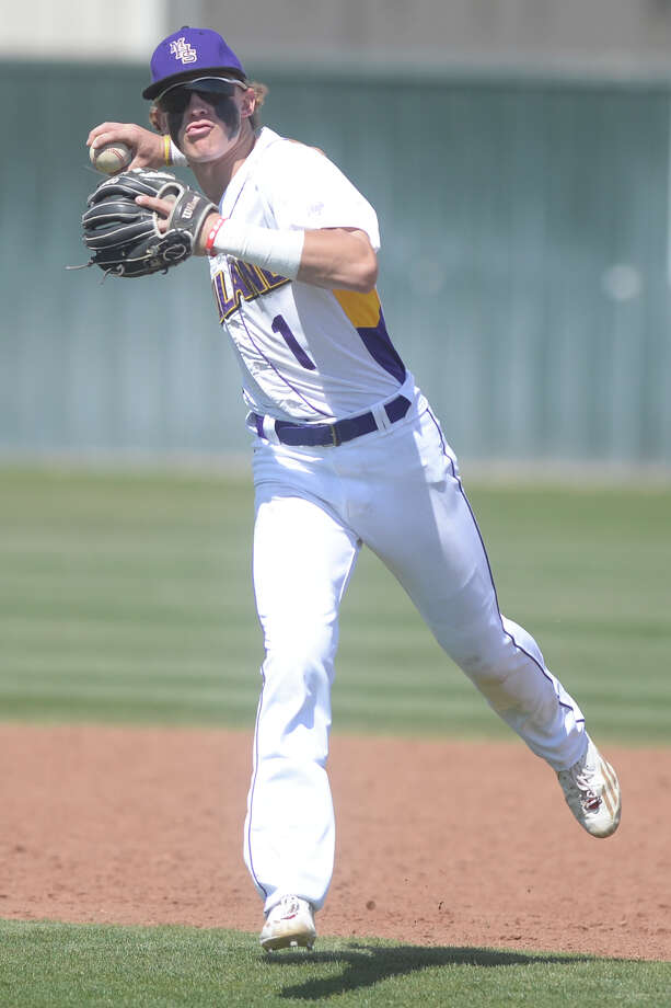 Midland High's Jaxon Hallmark (1) throws to first base for an out against Permian on March 16, 2017, at Zachery Field.   James Durbin/Reporter-Telegram Photo: James Durbin